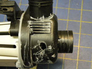Photograph 10: Fractures in the redesign drain pump housing with reinforcing ribs.