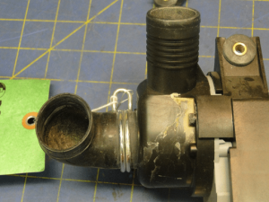 Photograph 9: Fractures in the plastic drain pump housing.