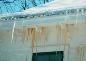 Photograph 2: Note the stained icicles adjacent to the exterior wall.